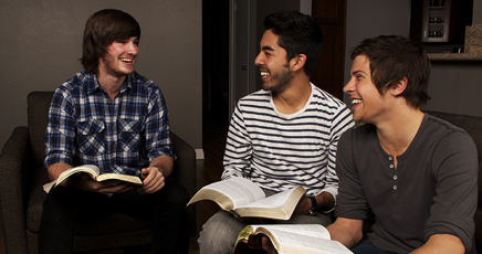 guys smiling with books