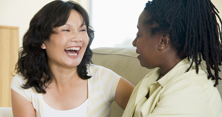 woman laughing with friend